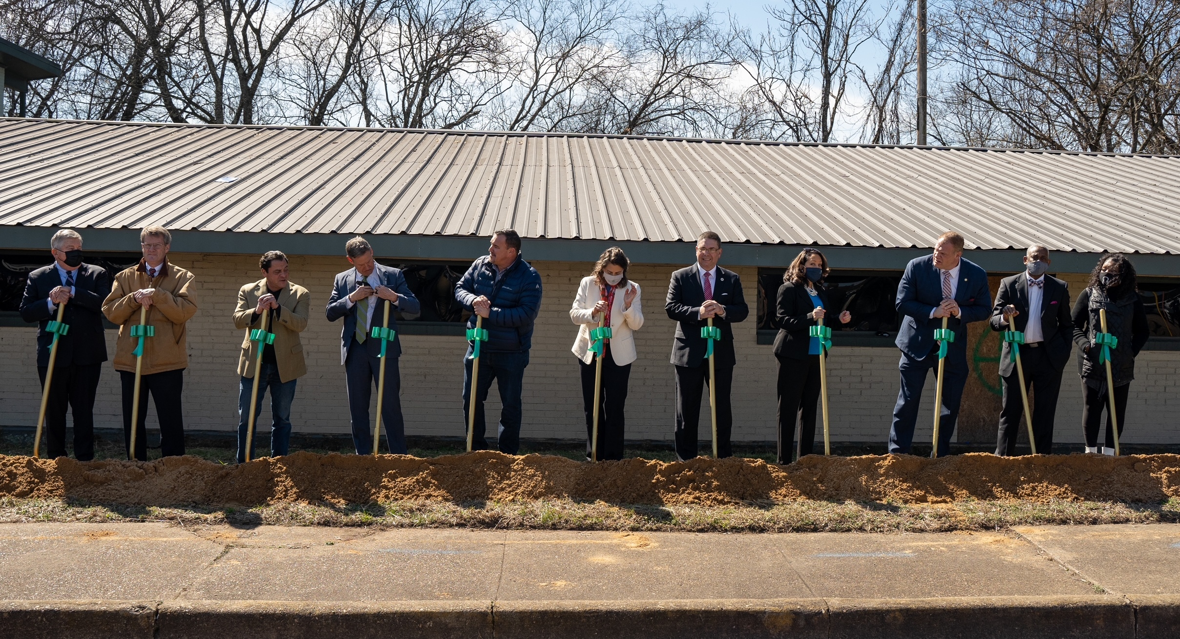 Community leaders in East Knoxville help break ground on Dogan Gaither Flats